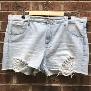Light wash boyfriend midi shorts distressed